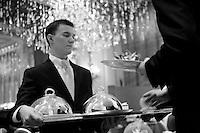 luncheon service at Restaurant Alain Ducasse, Hotel Plaza Athenee, paris<br /> <br /> <br /> Photograph by Owen Franken