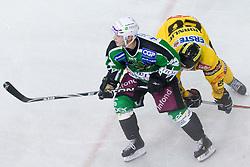 John Hughes (HDD Tilia Olimpija, #72) and Dan Bjornlie (EV Vienna Capitals, #28) at 1st Round ice hockey match of EBEL league between HDD Tilia Olimpija and EV Vienna Capitals, on September 10, 2010, in Hala Tivoli, Ljubljana, Slovenia. (Photo by Matic Klansek Velej / Sportida)