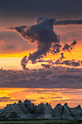 Unusual shaped clouds after a storm over the peaks of the Badlands National Park in South Dakota, USA. Most of the rainfall in the Badlands region falls in the period from May to July, often in the form of powerful storms, sometimes loosely referred to as monsoons.