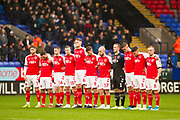 Fleetwood Town holding a minute of respect  before the EFL Sky Bet League 1 match between Bolton Wanderers and Fleetwood Town at the University of  Bolton Stadium, Bolton, England on 2 November 2019.