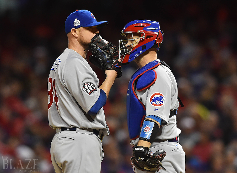 Oct 25, 2016; Cleveland, OH, USA; Chicago Cubs starting pitcher Jon Lester (34) talks with catcher David Ross (3) in the first inning against the Cleveland Indians in game one of the 2016 World Series at Progressive Field. Mandatory Credit: Ken Blaze-USA TODAY Sports