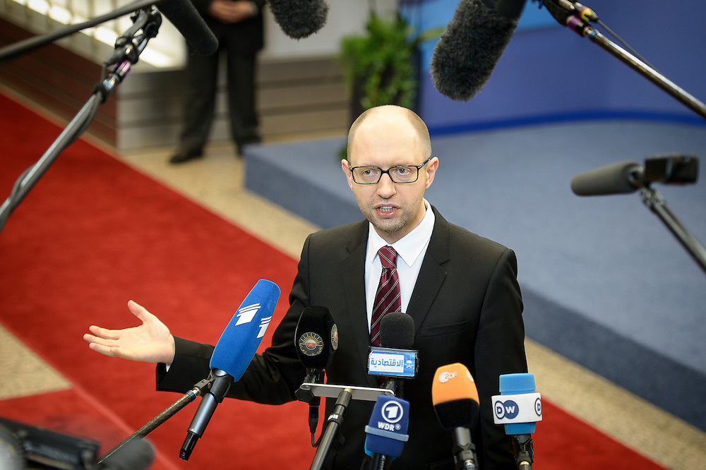Ukraine Prime Minister Arseniy Yatsenyuk  holds press conference after signing the political provisions of the Association Agreement with EU during  the second day of the spring European head of states Summit at the EU council headquarters in Brussels, Belgium on 21.03.2014    by Wiktor Dabkowski