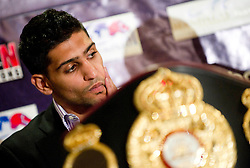 Amir Khan talks to journalists during a press conference organized by Golden Boy Promotions in association with Khan Promotions and Universum Box Promotions, to announce the the world title clash between reigning WBA Super Lightweight World Champion Amir Khan and Argentine WBA Super Lightweight Interim World Champion Marcos Maidana, in London, wednesday, 23 september 2010.