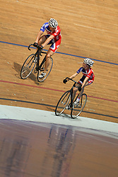 © Licensed to London News Pictures. 25/09/2012. Manchester, UK. Sir Chris Hoy races with Lauren Booth (11), from Chippenham in Wiltshire , at the National Cycling Centre . Lauren won the Sky Rides competition to find Britain's Biggest Cycling Fan . Sky Ride competition entrants won the opportunity to cycle with the Olympic Gold Medallist . Photo credit : Joel Goodman/LNP