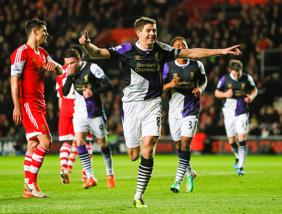 Liverpool's Steven Gerrard runs towards the travelling fans to celebrate his penalty kick against Southampton. The win sparked talk of the Reds possibly winning the 2014 season.