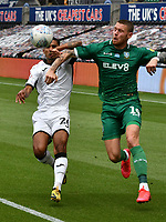 Football - 2019 / 2020 Championship - Swansea City vs Sheffield Wednesday<br /> <br /> Connor Wickham of Sheffield Wednesday with raised elbow & Kyle Naughton of Swansea City<br /> in a match played with no crowd due to Covid 19 coronavirus emergency regulations, at the almost empty Liberty Stadium.<br /> <br /> COLORSPORT/WINSTON BYNORTH