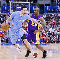 06 April 2014: Los Angeles Clippers guard J.J. Redick (4) drives past Los Angeles Lakers guard Jodie Meeks (20) during the Los Angeles Clippers 120-97 victory over the Los Angeles Lakers at the Staples Center, Los Angeles, California, USA.