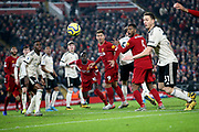 Everybody watches as the ball flies across the face of goal and goes narrowly wide during the Premier League match between Liverpool and Manchester United at Anfield, Liverpool, England on 19 January 2020.
