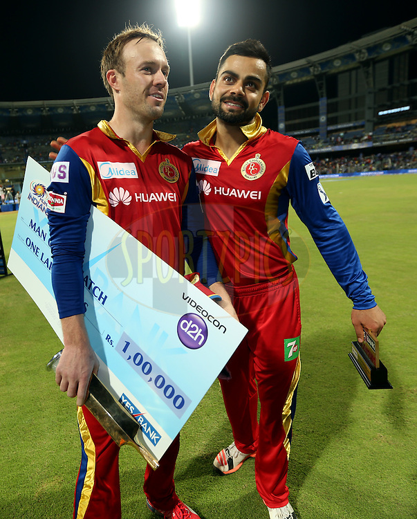 Royal Challengers Bangalore player AB De Villiers and Royal Challengers Bangalore captain Virat Kohli after winning the  match 46 of the Pepsi IPL 2015 (Indian Premier League) between The Mumbai Indians and The Royal Challengers Bangalore held at the Wankhede Stadium in Mumbai, India on the 10th May 2015.<br /> <br /> Photo by:  Sandeep Shetty / SPORTZPICS / IPL