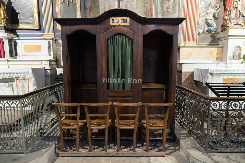 confession stand with chairs inside the church in Saint Remy De Provence