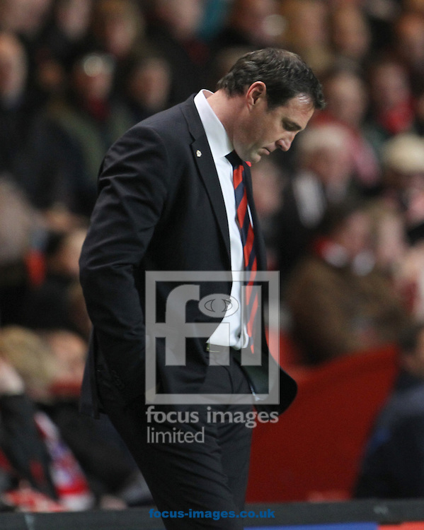 .Picture by Daniel Weir/Focus Images Ltd +44 7982 911743.06/11/2012.Malky Mackay manager of Cardiff City looks dejected as his side go from 2-0 up to losing 5-2 and finished the match losing 5-4 during the npower Championship match against Charlton Athletic at The Valley, London.