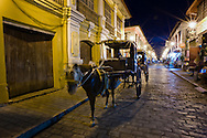 Kalesa on the street in Vigan at night.<br />