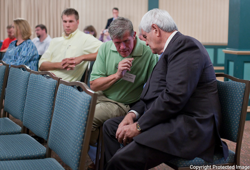 Former House Speaker Newt Gingrich (right) talks with US House candidate and current Iowa State Senator Brad Zaun (R-IA32) before he speaks to area business leaders at the Pella Opera House in Pella, Iowa on Thursday September 9, 2010. (Stephen Mally for The New York Times)
