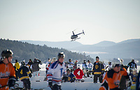 A helicopter takes off from Meredith Bay for a scenic ride during New England Pond Hockey Saturday morning.  (Karen Bobotas/for the Laconia Daily Sun)