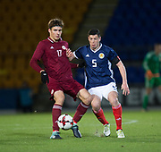10th November 2017, McDiarmid Park, Perth, Scotland, UEFA Under-21 European Championships Qualifier, Scotland versus Latvia; Latvia's Roberts Uldrikis and Scotland's Scott McKenna