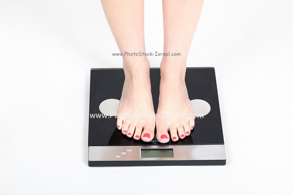Woman's feet on scale Model released