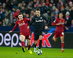 SALZBURG, AUSTRIA - Tuesday, December 10, 2019: Liverpool's Andy Robertson (L) and FC Salzburg's Dominik Szoboszlai during the final UEFA Champions League Group E match between FC Salzburg and Liverpool FC at the Red Bull Arena. (Pic by David Rawcliffe/Propaganda)