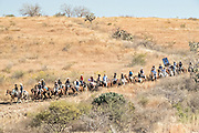 Hundreds of Mexican cowboys ride through the high desert during the annual Cabalgata de Cristo Rey pilgrimage January 5, 2017 in La Trinidad, Guanajuato, Mexico. Thousands of Mexican cowboys and horse take part in the three-day ride to the mountaintop shrine of Cristo Rey stopping along the way at shrines and churches.