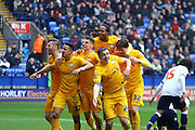 Preston players celebrate as Jordan Hugil makes it 1-1 during the Sky Bet Championship match between Bolton Wanderers and Preston North End at the Macron Stadium, Bolton, England on 12 March 2016. Photo by Pete Burns.