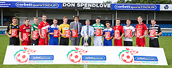 RHYL, WALES - Tuesday, August 20, 2013: Wales national team manager Chris Coleman with Mike Corbett and 12 players from each of the Welsh Premier League teams show racism the red card as they help launch the Corbett Sports Welsh Premier League at Rhyl Football Club. (Pic by David Rawcliffe/Propaganda)