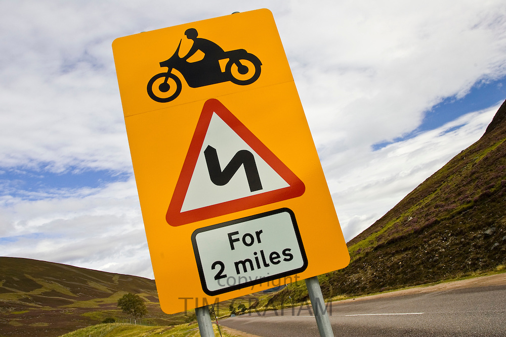 Roadsign warning of dangerous bends ahead in Glenshee, Scotland