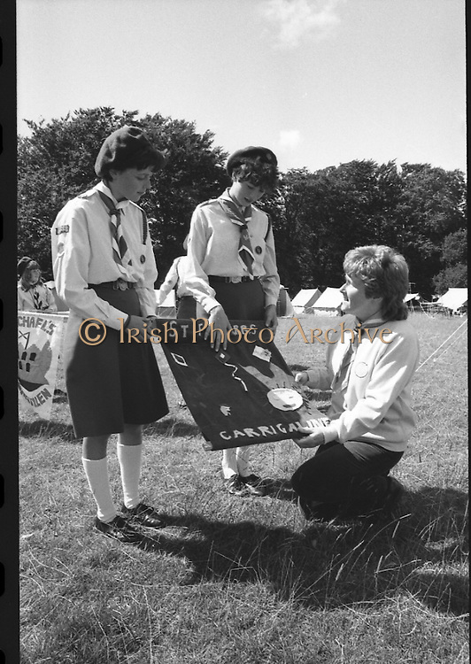 300 Girl Guides At Larch Hill.  (R84)..1988..25.07.1988..07.25.1988..25th July 1988..As part of the Diamond Jubilee celebrations the girl guide movement organised a friendship camp for 300 girls.The friendship camp was set up in the grounds of Larch Hill, Tibradden,Co Dublin. The camp will run from 23rd July to 30th July...Image shows some guides from St Finbarrs, Carrigaline,Co Cork preparing their banner for display..