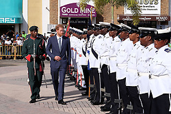 Kensington Palace handout photo of Prince Harry as he inspects a guard of honour at Port Zante after arriving on the island of St Kitts for the second leg of his Caribbean tour.