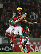 Maritimo´s player Edgar Costa (L ) fights for the ball with Benfica's player Fejsa   (R ) during Portuguese First League football match C.S. Maritimo vs S.L. Benfica held at Barreiros Stadium, Funchal, Portugal, 01 December, 2016.