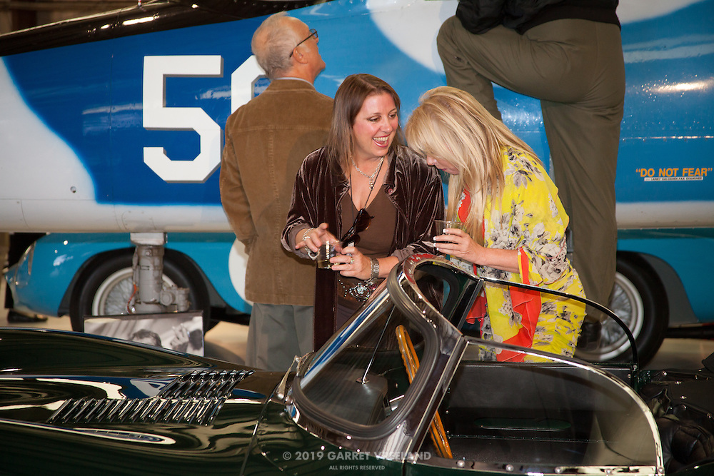 Attendees having a laugh over Steve McQueen's XKSS, Planes and Cars at the Santa Fe Airport, 2013 Santa Fe Concorso.