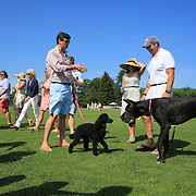 Owners with dogs meet on the field during the half time break during the Airstream vs. Cinque Terre Polo match at the Greenwich Polo Club, Greenwich, Connecticut, USA. 23rd June 2013. Photo Tim Clayton