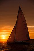 Mischief, S Class sailing at sunset.