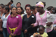 Central American migrants participate in a meeting in the Mexican Senate after arriving to Mexico City on April 24th, 2014. Migrants have to make deadly, irregular and clandestine travels hidden in the wagons and gonads of the train through Mexico during weeks to arrive to the U.S.  The train is nicknamed &quot;La Bestia&quot; (The Beast) due to its dangerousness.<br /> <br /> Each Holly Week, along with Mexican human rights activists, make religious and protest activities during the &quot;Viacrucis del migrante&quot;. <br /> <br /> This year, they walk on foot, since the evening of Thursday April 17th, after the train where they travel, under Ferrocarriles del Istmo enterprise orders, unhooked the gonads with people and left them abandoned in Tenosique. After being left, they made the decision to continue their way on foot. <br /> <br /> They have traveled on foot more than 100 km (328 000 ft) from Tenosique, Tabasco demanding an end to the violence against migrants and free transit through Mexico. (Photo credit: Prometeo Lucero)
