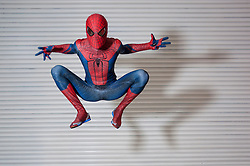 © Licensed to London News Pictures. 14/03/2015. Newham, London, UK.  A man takes to the air as Marvel's Spider-Man, in his homemade costume, one of many cosplayers attending the London Comic Con at the Excel Centre in Docklands. Photo credit : Stephen Chung/LNP
