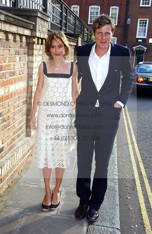 ZAC GOLDSMITH and his wife SHEHERAZADE at Sir David & Lady Carina Frost's annual summer party held in Carlyle Square, Chelsea, London on 5th July 2006.<br /><br />NON EXCLUSIVE - WORLD RIGHTS