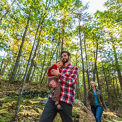 A young family hikes a forest trail at the Kenyon Hill preserve in South Berwick, Maine.