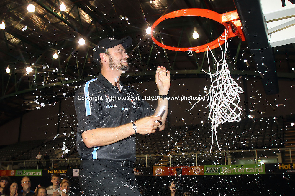 Breakers' Assistant Coach Judd Flavell gets the champagne treatment from the team. iinet ANBL, Grand Final Game 3, New Zealand Breakers vs Cairns Taipans, North Shore Events Centre, Auckland, New Zealand. Friday 29th April 2011. Photo: Anthony Au-Yeung / photosport.co.nz