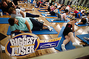 Guest workout before dawn at the Biggest Loser Resort in Ivins, Utah September 6, 2010.  Guests at the resort affiliated with the popular reality television show workout in an aerobics room, a gym and a swimming pool for 6 to 7 hours each day.  REUTERS/Rick Wilking (UNITED STATES)
