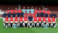 Arsenal Football Club 1st team squad Season 2000/1 - back row : Ashley Cole (29), Lauren (12), Graham Barrett (28), Stefan Malz (19), Alex Manninger (13), David Seaman (1), John Lukic (23), Robert Pires (7), Paolo Vernazza (30), Oleg Luzhny (22), Christopher Wreh (27). Middle row : Pat Rice (assistant manager), Tony Colbert (fitness coach),  Gary Lewin (physio), Paul Johnson (equipments manager), Boro Primorac (first team coach), Rhys Weston (32), Gilles Grimandi (18), Matthew Upson (20), Colin Lewin (assistant physio), Bob Wilson (goalkeeping coach), Joel Harris (masseur), George Armstrong (reserve team manager),  Vic Akers (kit manager). front row : Fredrik Ljungberg (8), Lee Dixon (2), Dennis Bergkamp (10), Kanu (25), Martin Keown (5), Arsene Wenger (manager), Tony Adams (6), Patrick Vieira (4),Thierry Henry (14),  Ray Parlour (15), Silvinho (16). Highbury Stadium, 11/8/2000. Credit Colorsport.