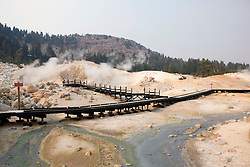A boardwalk allows visitors to safely view the geological features located in Bumpass Hell, the largest hydrothermal area in Lassen Volcanic National Park, California, USA.