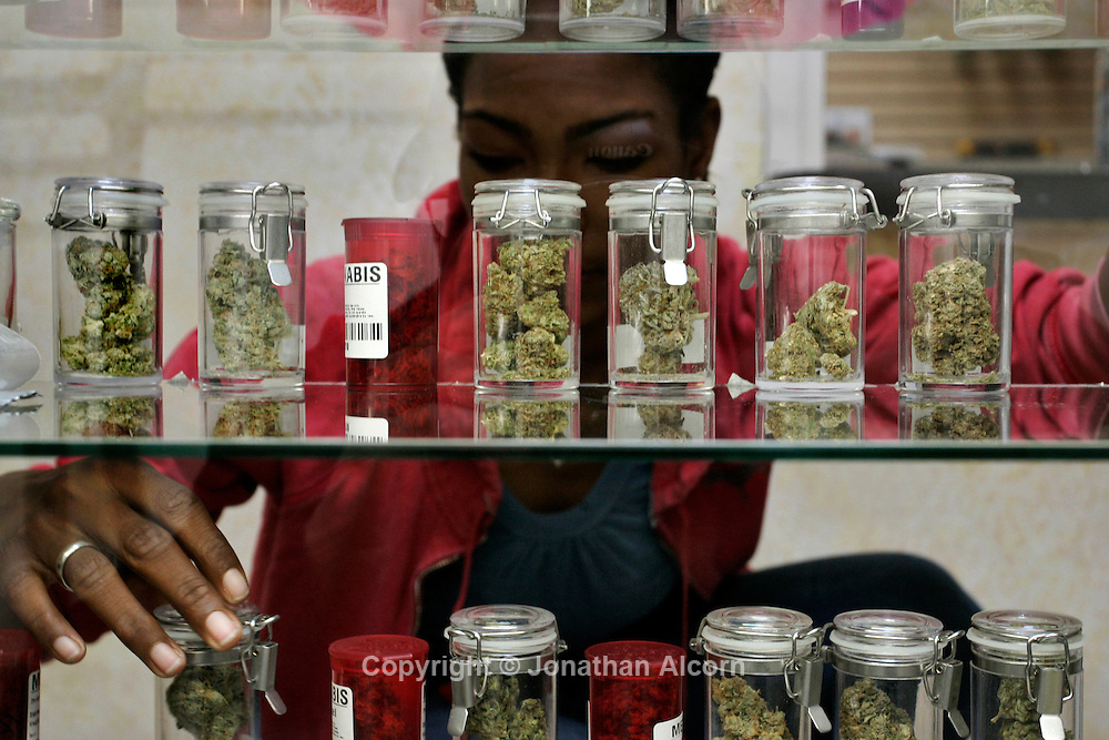 a UCFW union member and employee at the Venice Beach Care Center, organizes bottles of marijuana at the medical marijuana dispensary, in Los Angeles, California, February 6, 2013. The Venice Beach Care Center, is one of three medical marijuana shops in Los Angeles that are staffed by dues-paying union members. Another 49 dispensaries in the city plan to enter into labor agreements with the UFCW this year, the union says.
