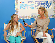 Jennie Garth and her daughter Lola, 9, discuss the importance of good oral care at the Crest and Oral-B Back-to-School launch event, Wednesday, August 8, 2012 in New York.  (Photo by Diane Bondareff/Invision for Crest and Oral-B/AP Images)
