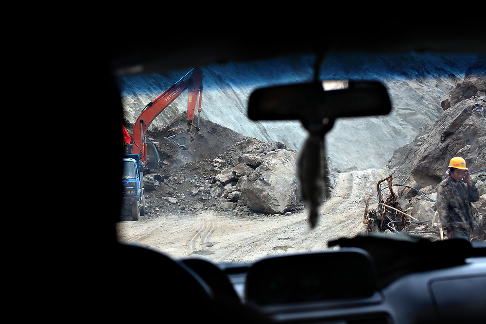 Roadwork on Highway 214 following the August 2013 earthquake, Yunnan, China; September, 2013.