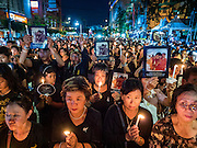 26 NOVEMBER 2016 - BANGKOK, THAILAND: A candlelight vigil for the late king of Thailand in Bangkok's Chinatown. Thousands of people gathered on Yaowarat Road in the heart of Bangkok's Chinatown to honor Bhumibol Adulyadej, the Late King of Thailand. The event was organized by the Thai-Chinese community and included a performance by the Royal Thai Navy orchestra of music composed by the Late King, a prayer by hundreds of Buddhist monks. It concluded with a candlelight vigil. The King died after a long hospitalization on October 13. The government has declared a one year mourning period. HRH Crown Prince Maha Vajiralongkorn, the Heir Apparent and Late King's son, is expected to be name the King next week. He will be known as Rama X.       PHOTO BY JACK KURTZ