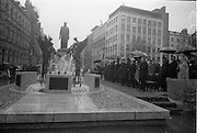 16/04/1966<br /> 04/16/1966<br /> 16 April 1966<br /> Unveiling of Thomas Davis Memorial at College Green, Dublin. The design by Irish sculptor Edward Delaney took the form of a statue fronted by a futuristic fountain on a cobblestone plinth. Picture shows the President de Valera and the distinguished gathering viewing the monument after the ceremony.