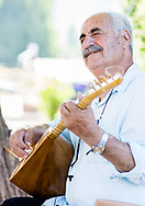 Munzur Valley, Turkey    - July 27, 2014 - Hasan Hayri Sanli, a highly respected dede (Alevi religious leader), plays the baglama and sings, near the source of the Munzur River. CREDIT: Michael Benanav for The New York Times