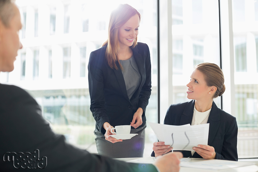 Businesswomen working at cafeteria