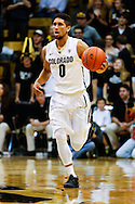 November 24th, 2013:  Colorado Buffaloes junior guard Askia Booker (0) brings the ball up the court in the second half of the NCAA Basketball game between the Harvard Crimson and the University of Colorado Buffaloes at the Coors Events Center in Boulder, Colorado