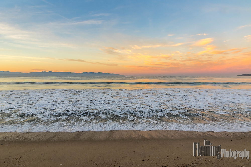 On the beach at sunrise in Bucerias, Nayarit, Mexico.