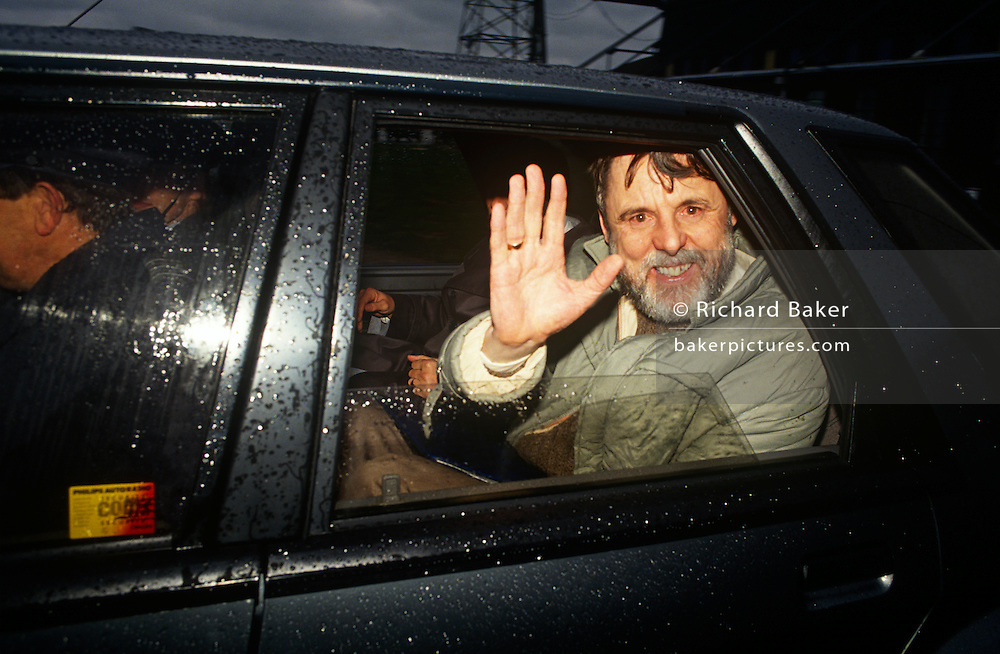The former Beirut hostage, the Church envoy, Terry Waite waves from a car, driven away after landing back in UK.