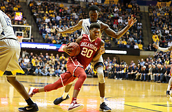 Jan 6, 2018; Morgantown, WV, USA; Oklahoma Sooners guard Kameron McGusty (20) drives down the lane during the first half against the West Virginia Mountaineers at WVU Coliseum. Mandatory Credit: Ben Queen-USA TODAY Sports